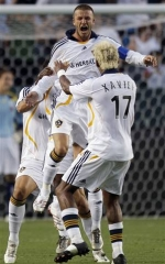 David Beckham celebrates his free kick goal with his Galaxy teammates