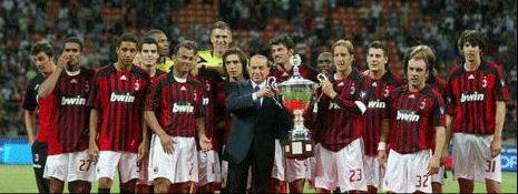 AC Milan's victory photo: president Berlusconi and captain Ambrosini hoist the trophy