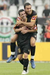Antonio Di Natale celebrates his goal with Fabio Quagliarella