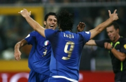 Fabio Grosso and Luca Toni celebrate the 2-0 goal for Italy