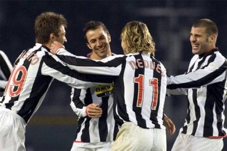 Criscito, Nedved, and Nocerino surround the Juve captain after his goal