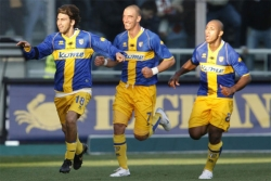 The Parma players celebrate the 1-0 lead