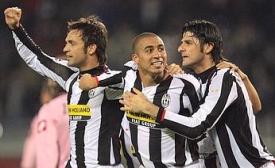 Legrottaglie, Trezeguet, and Iaquinta celebrate Juve's opener