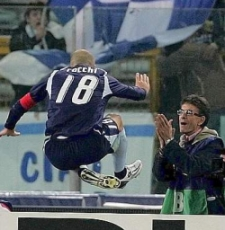 Tommaso Rocchi celebrates his goal by leaping over the advertisement boards