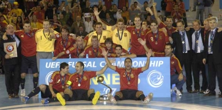 Spain celebrate with the trophy