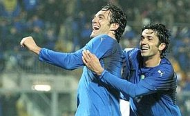 Luca Toni has just made it 2-0 for Italy, congratulated by Raffaele Palladino