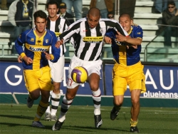 Stefano Morrone (on the right) tries to contain David Trezeguet