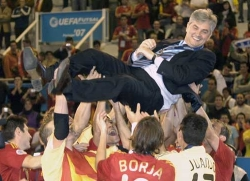 Spain coach José Venancio is chaired by his players after winning the final
