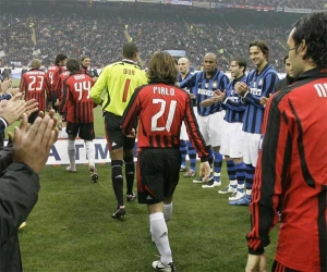 The Inter players applaud their AC Milan rivals, as they enter the San Siro stadium