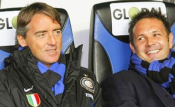 Inter coach Roberto Mancini with his assistant manager, Sinisa Mihaijlovic