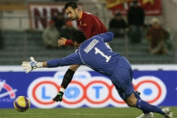 Vucinic through on goal, tries to beat a rushing out Marruocco