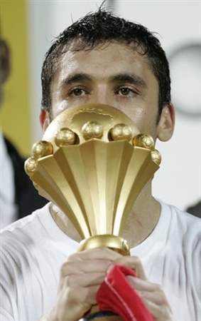 Egypt's captain Ahmed Hassan holds the trophy after they beat Cameroon in the African Nations Cup soccer final in Accra February 10, 2008.