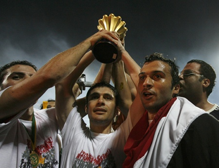 Egyptian players celebrate victory over Cameroon in their African Nations Cup soccer final match in Accra February 10, 2008.