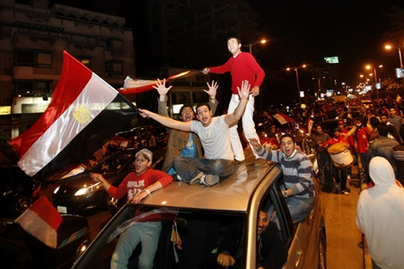 Egyptians celebrate the country's victory against Cameroon in the African Nations Cup final played in Ghana, in Cairo, February 10, 2008.