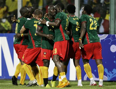 Cameroon's players celebrate a goal by their team mate Alain Nkong (unseen) against Ghana during their semi-final match at the African Nations Cup tournament, in Accra February 7, 2008.