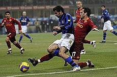 Marco Cassetti (right) tries to stop Luis Figo
