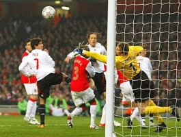Paolo Maldini's header finds the ready hands of Jens Lehmann