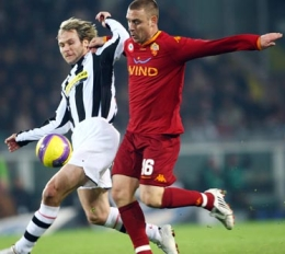 Pavel Nedved (left) battling it out with Daniele De Rossi