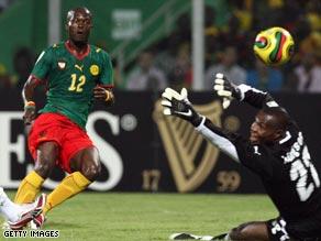 Alain Nkong sends the ball past Richard Kingson, to put Cameroon ahead 1-0