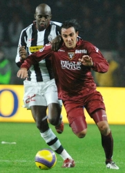 Simone Barone challenged by Mohamed Sissoko