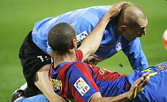 Christian Abbiati (top) after a challenge on Barcelona's Thierry Henry