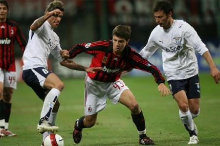 Valon Behrami (left) steals the ball from Alberto Paloschi
