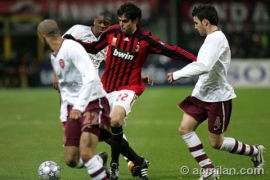 Kaká in action, surrounded by Fabregas and Clichy
