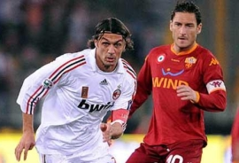 The two captains of the night: Paolo Maldini (left) and Francesco Totti
