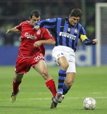 Javier Zanetti (right) protects the ball from Javier Mascherano