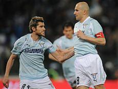 Tommaso Rocchi (right) celebrates his 2-1 penalty kick with Valon Behrami