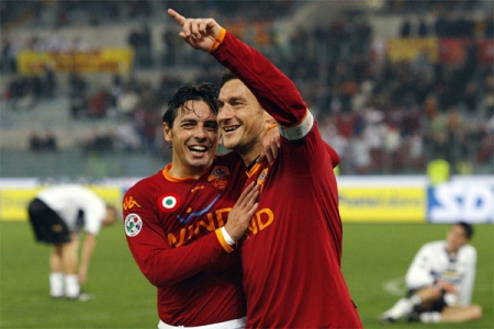 Totti and Esposito celebrate after Roma's third goal