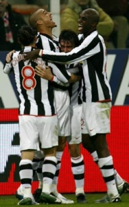 David Trezeguet surrounded by his team-mates after the 2-0 goal