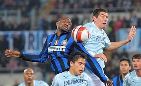Patrick Vieira (left) challenging an aerial ball with Ştefan Radu