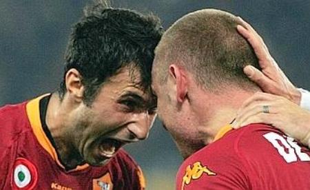 Mirko Vucinic (left) and Daniele De Rossi celebrate the 2-1 scoreline