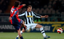 Cristiano Zanetti (right) attempts to challenge an Omar Milanetto pass