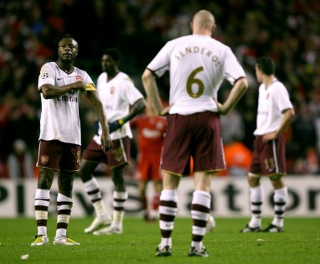 Arsenal players stand dejected after the final whistle. (Liverpool vs. Arsenal, UEFA Champions League, 2007-08)