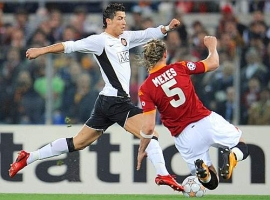 Philippe Mexès (right) tries to stop Cristiano Ronaldo with a tackle