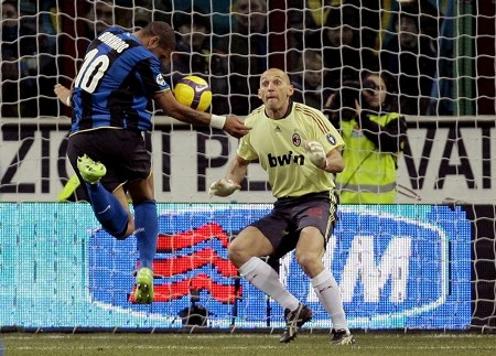 Inter Milan's Adriano (L) heads the ball to score past AC Milan's goalkeeper Christian Abbiati during their Italian Serie A soccer match at the San Siro stadium in Milan February 15, 2009. (REUTERS)