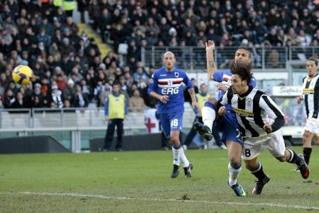 Juventus forward Amauri Carvalho de Oliveira scores the equalizing goal on a diving header during the Italian Serie A soccer match between Juventus and Sampdoria at the Olympic Stadium in Turin, Italy, Sunday, Feb. 15, 2009.