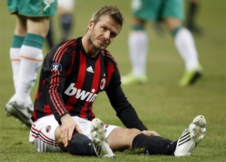 AC Milan English soccer star David Beckham reacts during a UEFA Cup, Round of 32, second-leg soccer match against Bremen , at the San Siro stadium, in Milan, Italy, Thursday, Feb. 26, 2009.  (AP Photo)