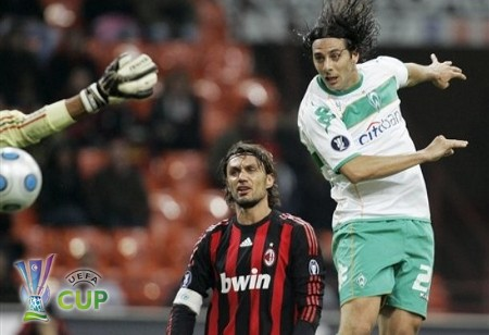 Bremen forward Claudio Pizarro, right, of Peru, scores a goal as AC Milan defender Paolo Maldini looks on during the UEFA Cup, Round of 32, second-leg soccer match between AC Milan and Bremen, at the San Siro stadium, in Milan, Italy, Thursday, Feb. 26, 2009. (AP Photo)