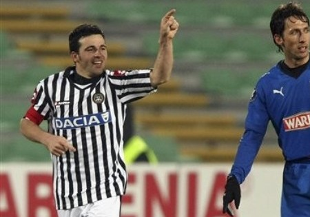 Udinese's Antonio Di Natale, left, celebrates after scoring as Lech Poznan's Marcin Kikut reacts during their UEFA Cup, Round of 32, second-leg soccer match between Udinese and Lech Poznan, at the Friuli Stadium in Udine , Italy, Thursday, Feb. 26, 2009.  (AP Photo)