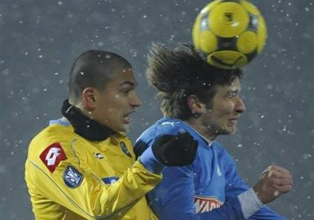 Udinese Calcio's Gokhan Inler, left, and Bartosz Bosacki of Lech Poznan fight for the ball during their UEFA Cup round of 32 first leg soccer match in Poznan, Poland, Thursday Feb. 19, 2009. (AP Photo by ALIK KEPLICZ)
