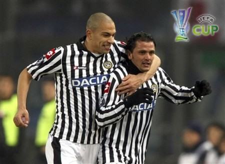 Udinese's Simone Pepe, right, celebrates with his teammates Gokhan Inler of Switzerland, during the UEFA Cup, Round of 32, second-leg soccer match between Udinese and Lech Poznan, at the Friuli Stadium in Udine , Italy, Thursday, Feb. 26, 2009.  (AP Photo)