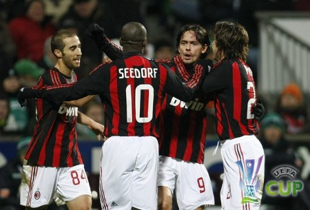 AC Milan's (from L) Mathieu Flamini, Clarence Seedorf, Filippo Inzaghi and Andrea Pirlo celebrate a goal against Werder Bremen during their UEFA Cup soccer match in Bremen February 18, 2009.  (REUTERS)