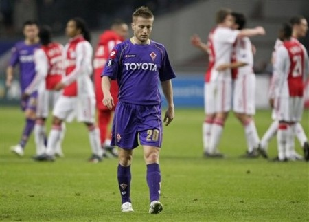 Fiorentina player Martin Jorgensen, center, reacts as Ajax players celebrate at the end of UEFA Cup round of 32 second leg soccer match at ArenA stadium in Amsterdam, Netherlands, Thursday Feb. 26, 2009. Ajax continues to the next round. (AP Photo)