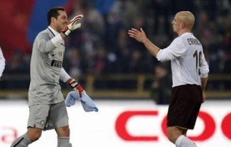 From left, Inter Milan forward Mario Balotelli, Brazilian goalkeeper Julio Cesar and Argentine midfielder Esteban Cambiasso react at the end of a Serie A soccer match against Bologna at the Dall'Ara stadium in Bologna, Italy, Saturday, Feb. 21, 2009. Inter won 2-1. (AP Photo by LUCA BRUNO)