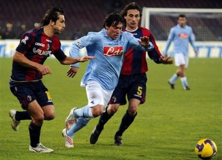 Napoli's Ezequiel Lavezzi, center, is boxed by Bologna's Davide Bombardini, left, and Sergio Volpi, during the Italian Serie A soccer match between Napoli and Bologna, in Naples' San Paolo stadium, southern Italy Saturday, Feb. 14, 2009. The match ended 1-1. (AP Photo by Salvatore Laporta)