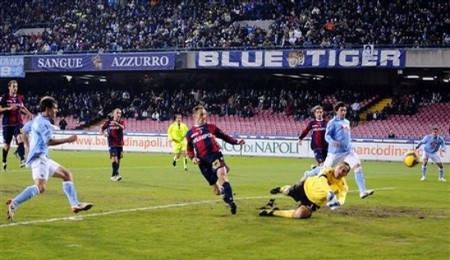 Napoli's Christian Maggio scores past Bologna defender Salvatore Lanna, and goalkeeper Francesco Antonioli, forground, from left, during the Italian Serie A soccer match between Napoli and Bologna, in Naples' San Paolo stadium, southen Italy Saturday, Feb. 14, 2009. (AP Photo by FRANCESCO CASTANO')