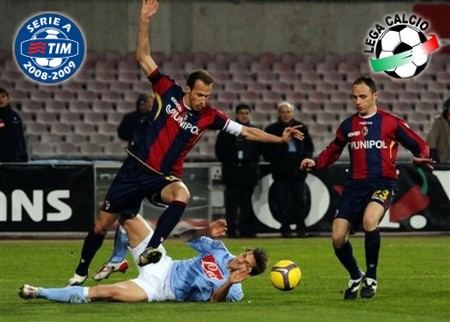 Napoli's Christian Maggio, on ground, is pressed by Bologna defender Salvatore Lanna, right, and Vangelis Moras during the Italian Serie A soccer match between Napoli and Bologna, in Naples' San Paolo stadium, southen Italy Saturday, Feb. 14, 2009. (AP Photo by FRANCESCO CASTANO')
